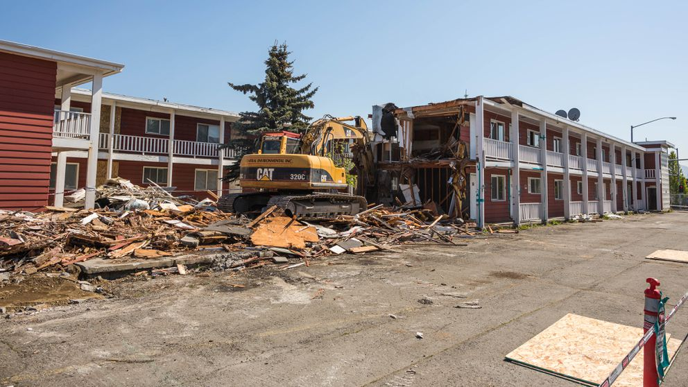 Contractors with Central Environmental Services begin the demolition of the Sourdough Lodge in Government Hill on May 29, 2015. (Loren Holmes / ADN)