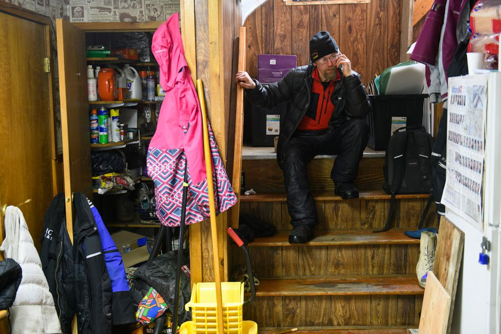 Three-time Iditarod champ Mitch Seavey talks on the phone in the Takotna community hall during a stop in Takotna. Many teams took their mandatory 24-hour rest in Takotna during the Iditarod Trail Sled Dog Race on March 6, 2019. (Marc Lester / ADN)