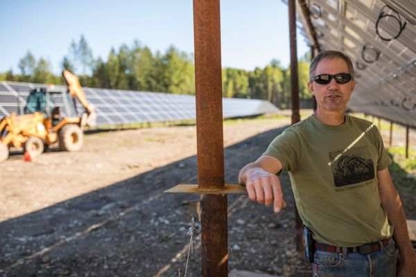 Sam Dennis takes a break from a wiring project at a solar farm operated by Renewable IPP in Willow Wednesday, Aug. 29, 2018. When the 100-kilowatt project is turned on in September it will briefly be the state's biggest. Golden Valley Electric Association is building a 563-kilowatt project in Fairbanks that is expected to be complete later this fall. (Loren Holmes / ADN)