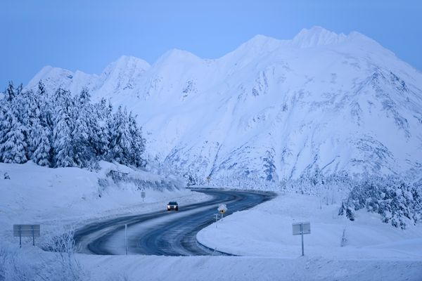 A car travels southbound on the Seward Highway at Turnagain Pass on Thursday, December 24, 2015.
