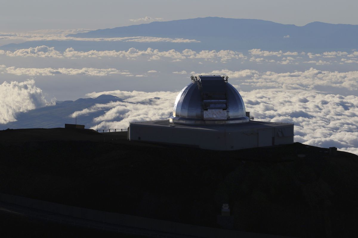 In this Sunday, July 14, 2019, file photo, a telescope at the summit of Mauna Kea, Hawaii's tallest mountain is viewed. Astronomers using a giant telescope planned for Hawaii's tallest peak will be able to study how the earliest galaxies formed not long after the Big Bang more than 13 billion years ago, which will inform humanity's understanding of how the universe came to be what it is today. They will be able to study planets orbiting stars other than our own with much greater detail. (AP Photo/Caleb Jones, File)