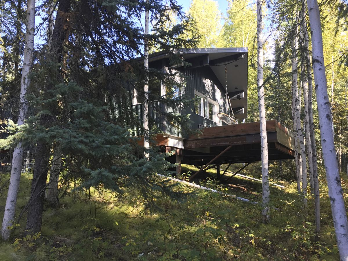 In this Sept. 7, 2018 photo, one of two cabins that Ilya Benesch is building on a property underlain with permafrost in Fairbanks. (Ravenna Koenig/Alaska's Energy Desk via AP)