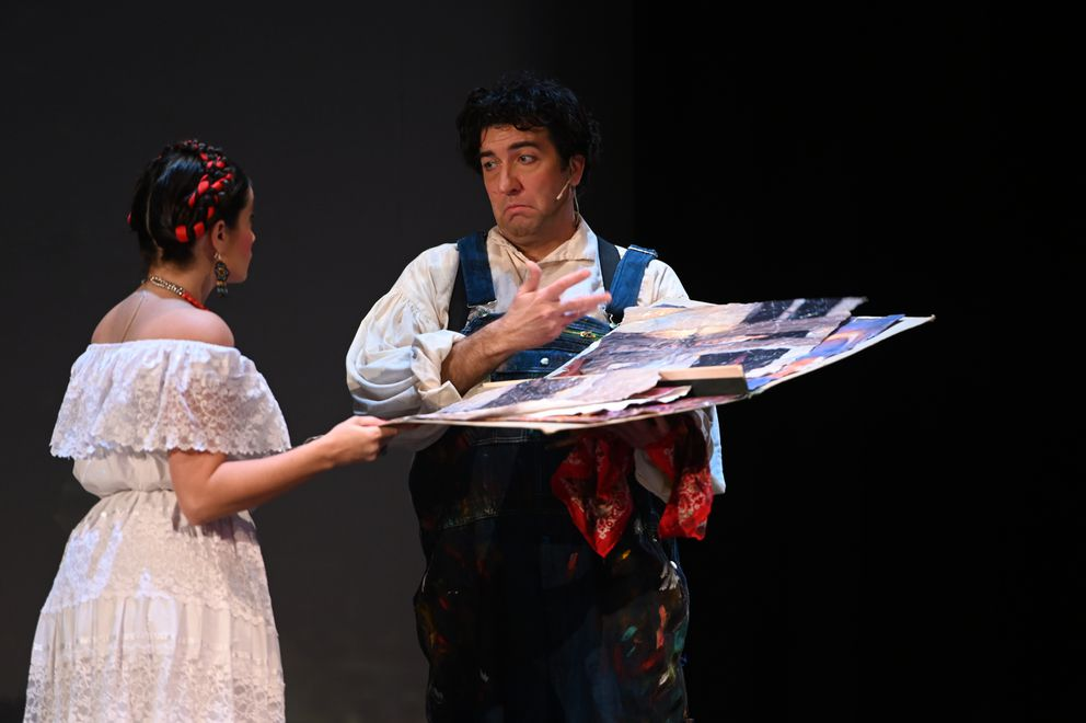 Mexican artist Frida Kahlo (Catalina Cuervo) shows her paintings to famed muralist Diego Rivera (Bernardo Bermudez) in the Anchorage Opera production of 'Frida. ' (Bill Roth / ADN)