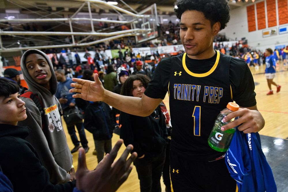 Daishen Nix is greeted by people as he walks off the floor at West High School on January 23, 2020. Nix was recently named a McDonald's All-American high school basketball player. (Marc Lester / Anchorage Daily News)