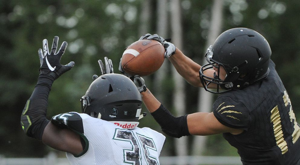 South's Allen Tadhg pulls in a pass as Colony's Julian McPhail defends. (Bob Hallinen / ADN)