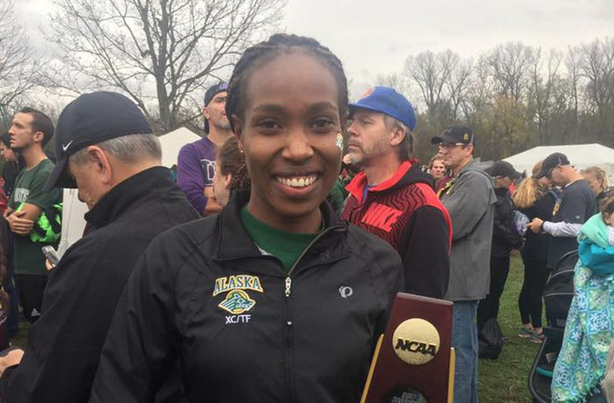 UAA's Caroline Kurgat holds her national championship trophy after winning the Division II cross-country title in November in Evansville, Indiana. (Photo courtesy of UAA)