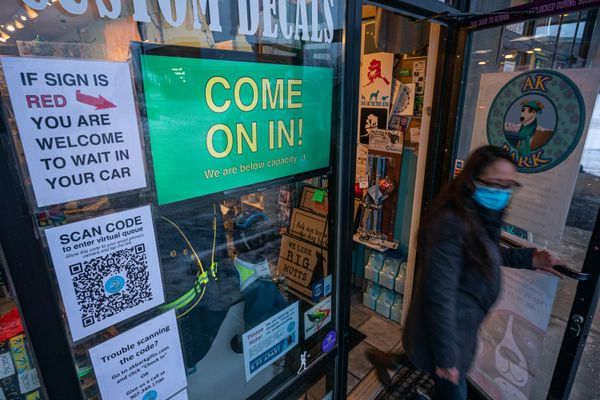 """A customer leaves after shopping at AK Bark on Thursday, Dec. 10, 2020. AK Bark's owner Mark Robokoff says they have been """"on the more careful end of the spectrum."""" Their in-store protocol allows for two customers to shop in-person at a time. (Loren Holmes / ADN)"""