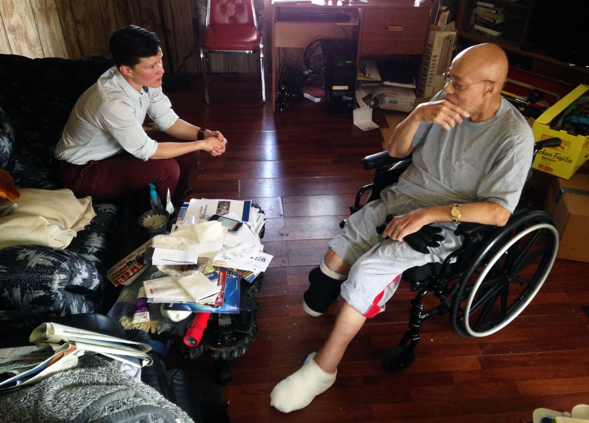 Dr. Devery Mitchell interviews Richard Keith during a house call at his home on April 20 in Anchorage. Keith lost his foot to an infection. (Charles Wohlforth / Alaska Dispatch News)