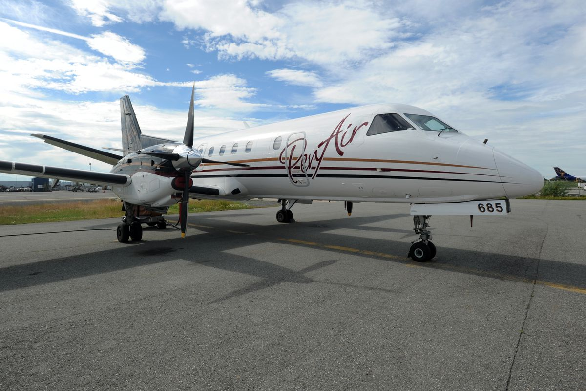 A PenAir Saab 340 twin-engine turboprop aircraft sits on the tarmac on Monday, August 7, 2017, at Ted Stevens Anchorage International Airport. (Erik Hill / ADN)