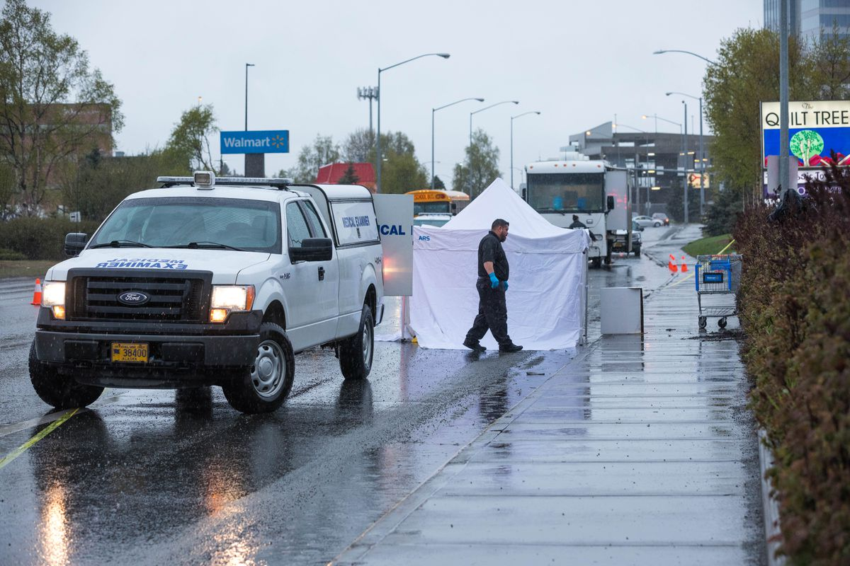 The state medical examiner responds to what Anchorage Police described as a fatal hit-and-run collision on East Benson Boulevard in Midtown Anchorage on Wednesday morning, May 8, 2019. (Loren Holmes / ADN)