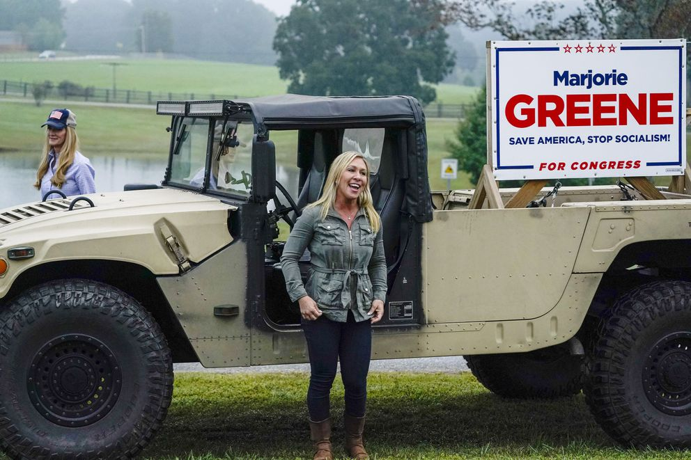 Sen. Kelly Loeffler, R-Ga., left, and congressional candidate Marjorie Taylor Greene, right, arrive at a news conference on Thursday, Oct. 15, 2020, in Dallas, Ga. (AP Photo/Brynn Anderson)