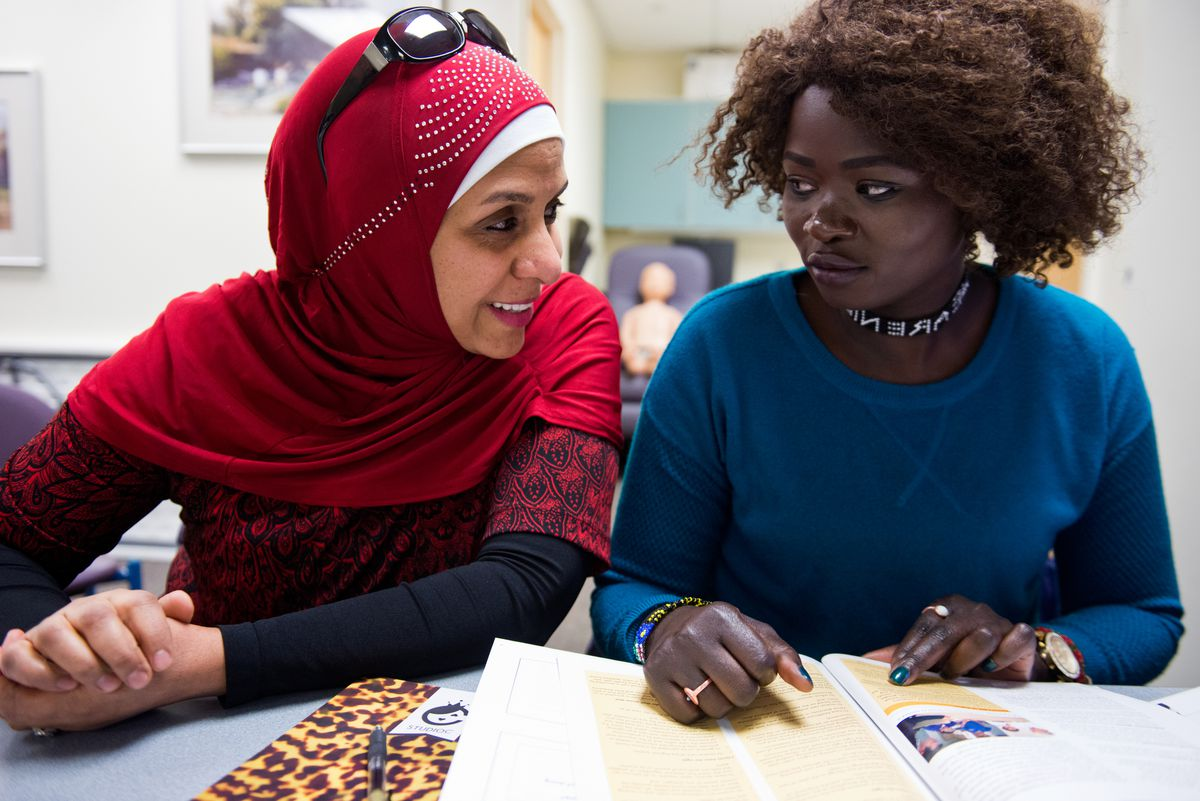 Zabeeba Mohamed assists in a class for students, like Nyanchiew Bichock, right, learning to become personal care attendants. The class was held at Providence Alaska Medical Center on Jan. 24, 2017. (Marc Lester / Alaska Dispatch News)