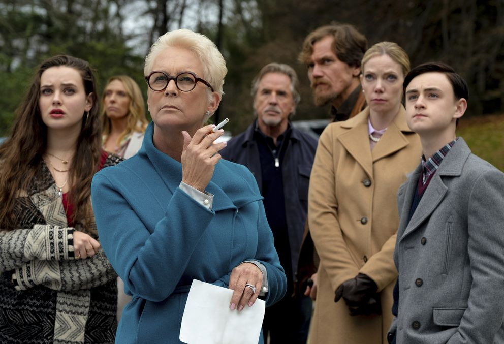 This image released by Lionsgate shows Katherine Langford, from left, Toni Collette, Jamie Lee Curtis, Don Johnson, Michael Shannon, Riki Lindholm and Jaeden Lieberher in a scene from 'Knives Out. ' (Claire Folger/Lionsgate via AP)