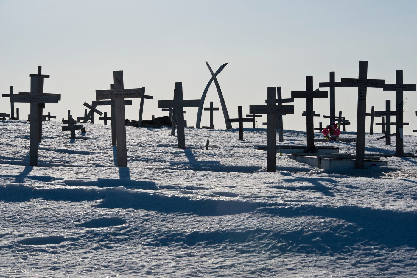 Whale bones create an archway over crosses at the Savoonga cemetery. (Marc Lester / Alaska Dispatch News)