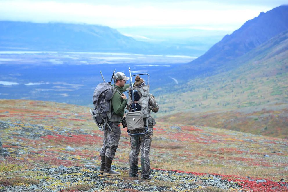 Lee and Mary Kuepper discuss options during a caribou hunt in the Maclaren area along the Denali Highway. (Buck Kunz) ONE TIME USE
