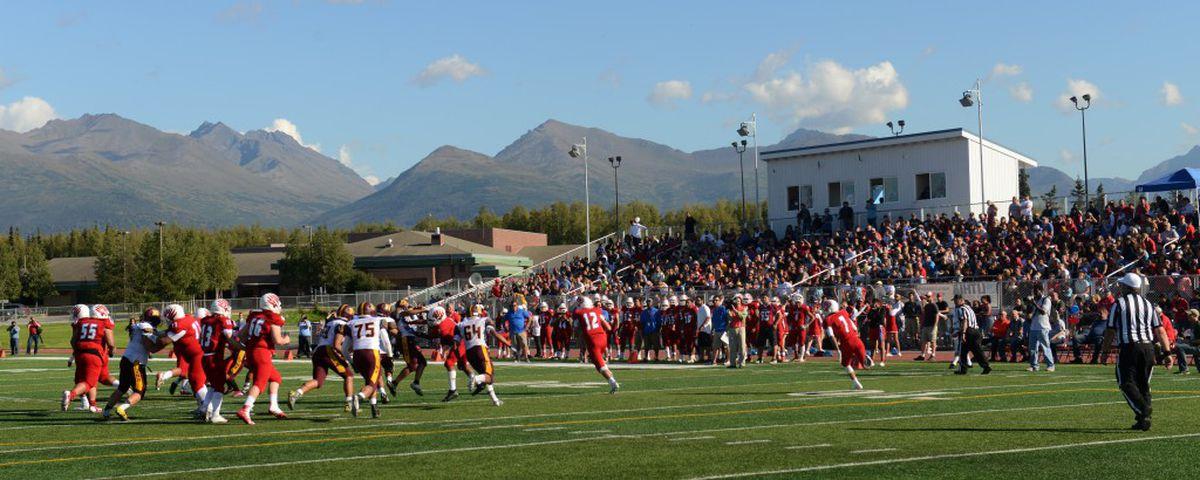 East quarterback Carson Washburn runs the ball against the Dimond during Saturday's grand opening of the school'snew Thunderbird stadium. (Bob Hallinen / Alaska Dispatch News)