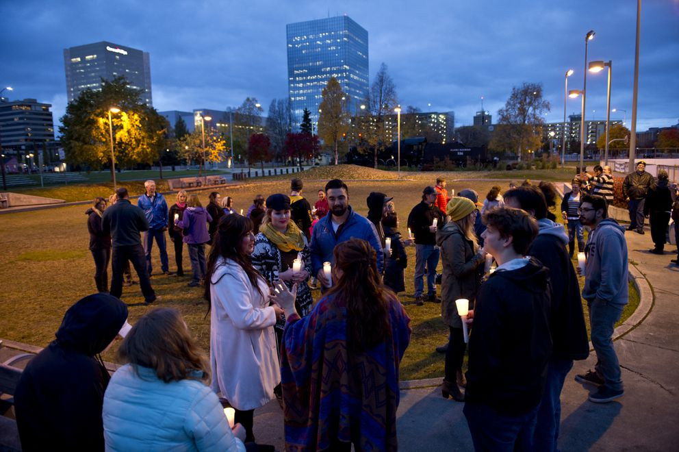 The small crowd lingered to talk at the conclusion of the short vigil.  (Marc Lester / Alaska Dispatch News)