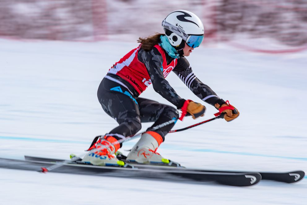 Ava Schweiger, an Alyeska Ski Club U16 racer, speeds between gates Sunday at Alyeska. She was the overall winner in the first race and the runnerup in the second. (Photo by Bob Eastaugh)