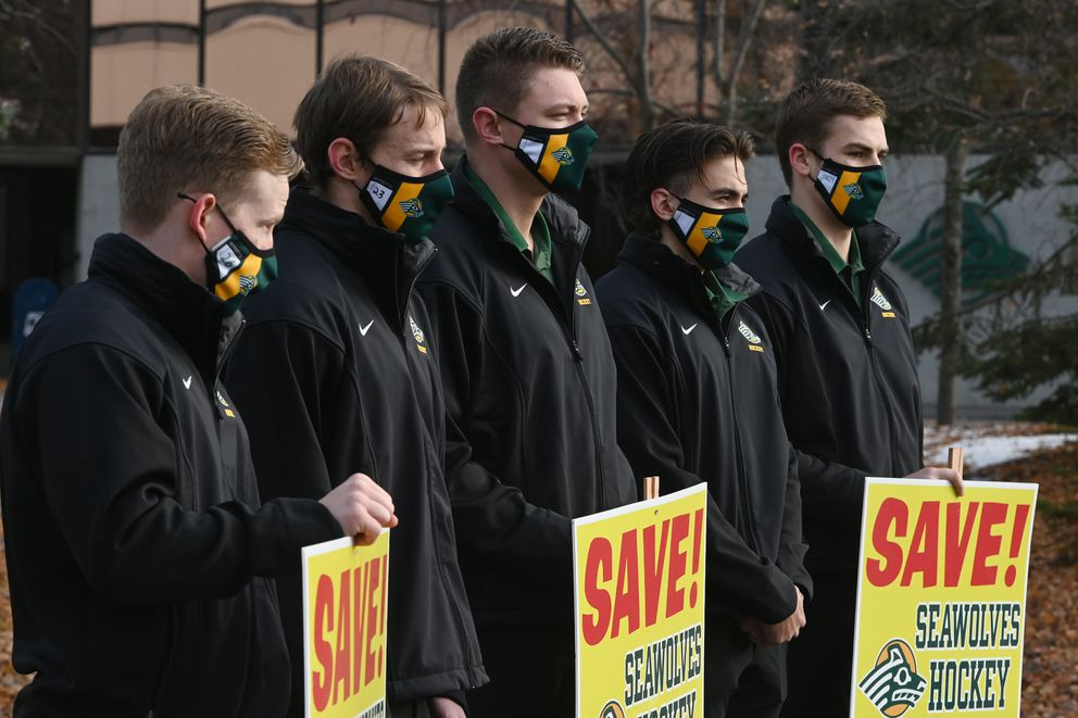 UAA players make a show of support for their program. (Bill Roth / ADN)