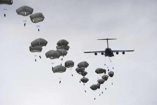 Pictured: More than 400 paratroopers from the 4th Infantry Brigade Combat Team (Airborne), 25th Infantry Division, jumped from U.S. Air Force C-17 Globemaster aircraft from JBER, Joint Base Lewis-McCord, Altus A.F.B, as well as an Alaska Air National Guard C-130 on Wednesday, March 18, 2015, at the Malemute Drop Zone on Joint Base Elmendorf-Richardson.