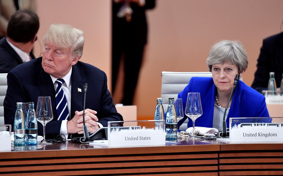 FILE: US President Donald Trump and Britain's Prime Minister Theresa May at the G20 meeting in Hamburg, Germany, July 7, 2017. REUTERS/John MACDOUGALL/Pool