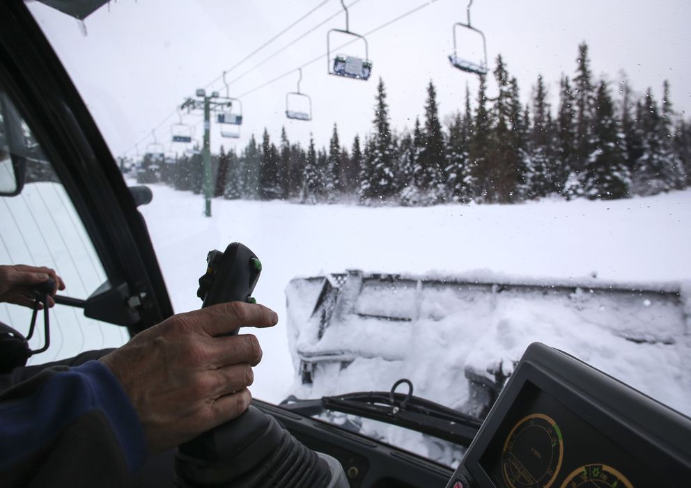 Bob Johnson moves snow using a large snowcat while grooming trails at Hilltop Ski Area ahead of their opening day on Wednesday, Nov. 25, 2020. (Emily Mesner / ADN)
