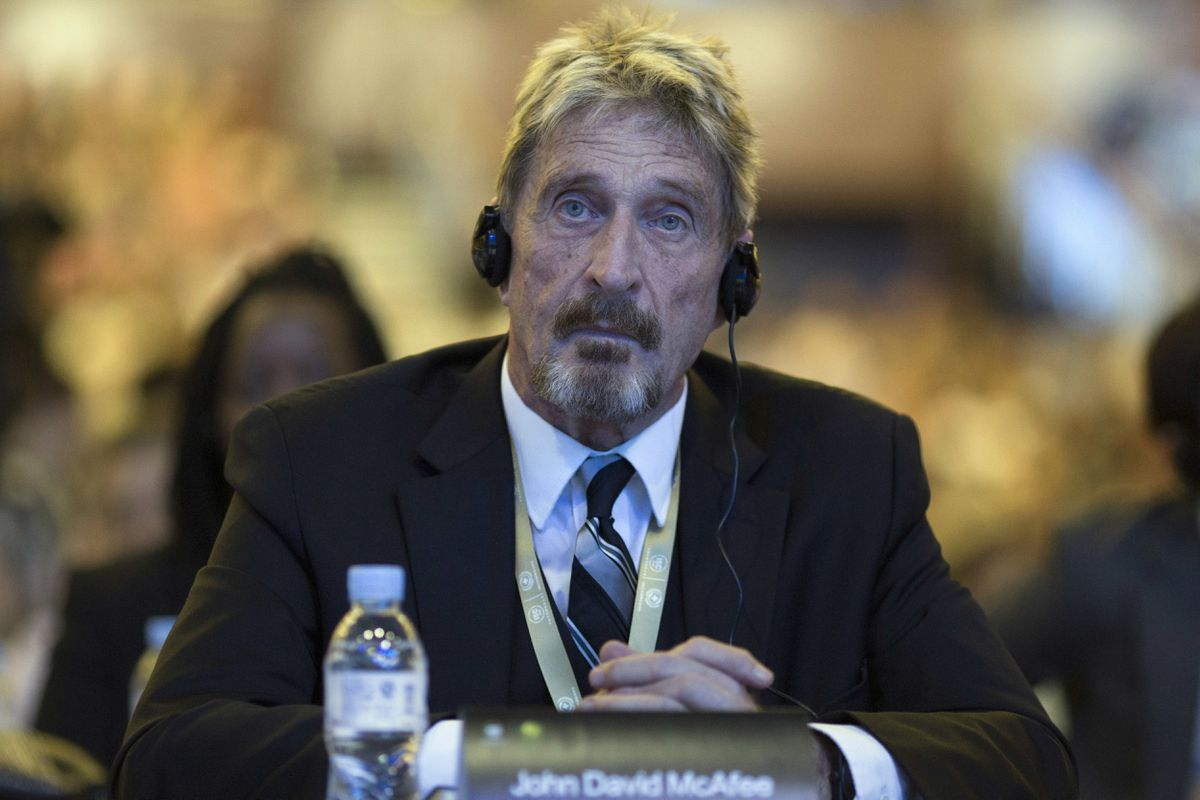 In this Aug. 16, 2016 photo, founder of the first commercial antivirus program that bore his name, John McAfee listens during the 4th China Internet Security Conference (ISC) in Beijing. (AP Photo/Ng Han Guan, File)