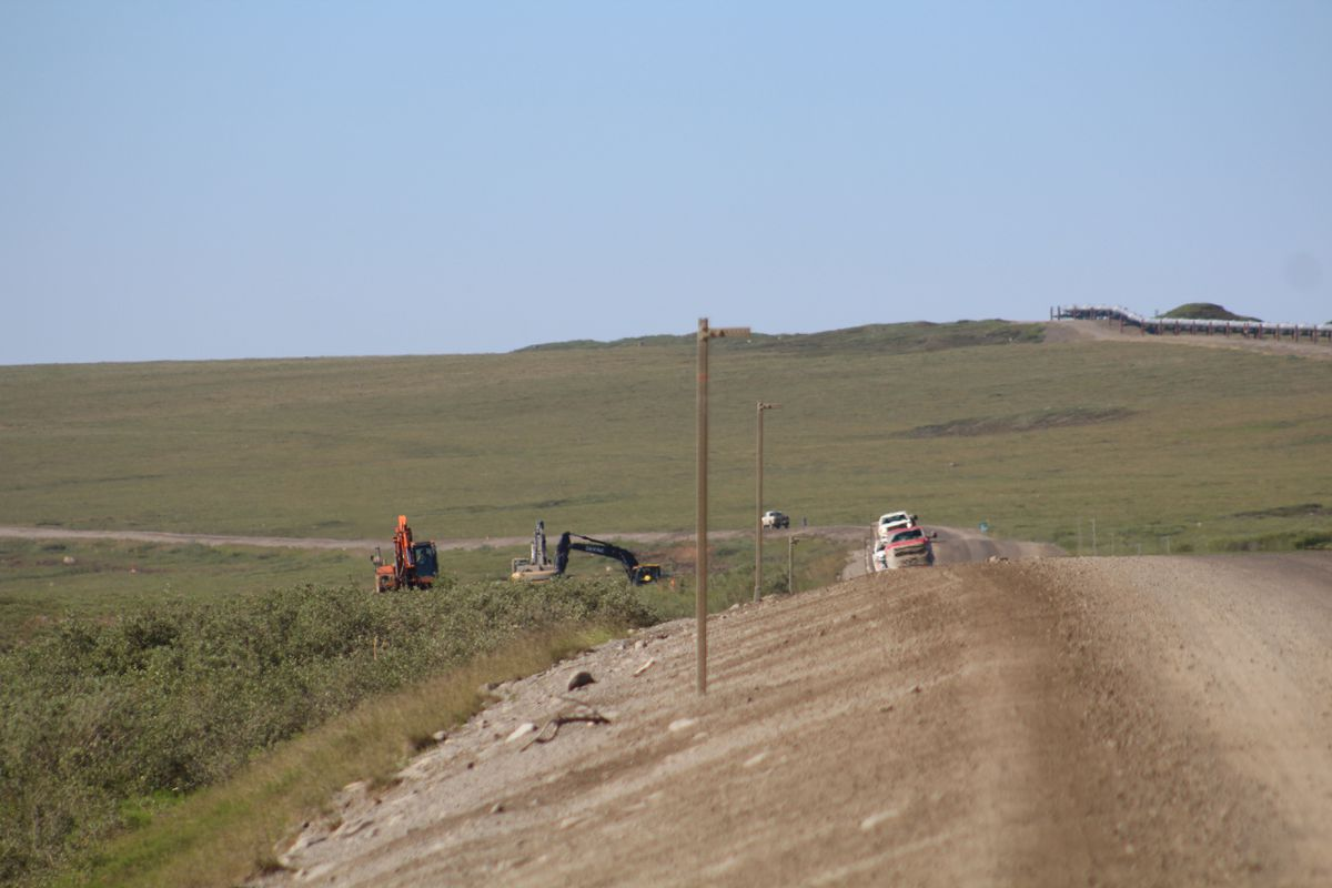 A construction crew works on the fiber optic cable project along the Dalton Highway in early July. (Dermot Cole/Alaska Dispatch News)