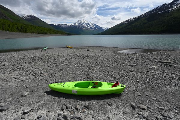A recreational kayak rests on the shore of Eklutna Lake on Thursday, June 10, 2021. The kayak is believed to have been the one used by a kayaker who was rescued a couple days earlier when it overturned. (Bill Roth / ADN)