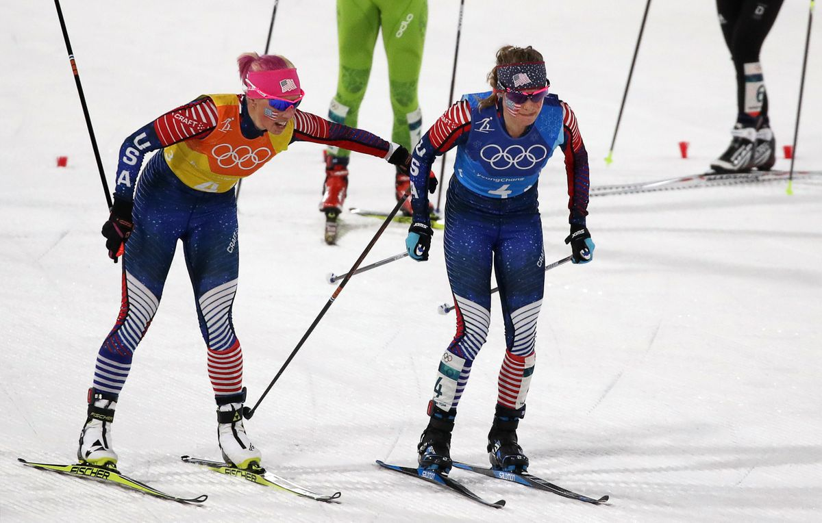 Kikkan Randall tags off to Jessie Diggins after the third leg of the women's 4×5-kilometer relay at the Winter Olympics. (REUTERS/Carlos Barria)
