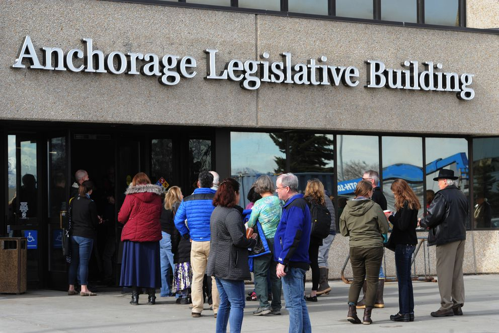 People wait in line outside the Anchorage Legislative Building prior to the start of State House budget input hearing on Sunday, March 24, 2019. (Bill Roth / ADN)