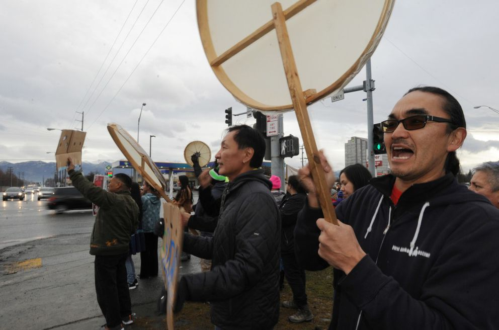 Ossie Kairaiuak, right, sang Yup'ik songs as Alaskans gathered at the corner of Northern Lights Boulevard and Seward Highway in Anchorage to show they support for the Standing Rock Sioux Tribe with their battle against the Dakota Access Pipeline on Sunday, Oct. 30, 2016, in Anchorage. (Bill Roth / Alaska Dispatch News)