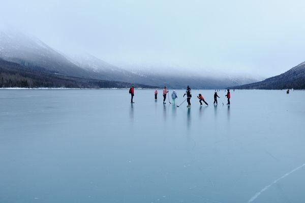 Skaters enjoy the smooth ice at Eklutna Lake north of Anchorage on Monday, Jan. 1, 2018. (Bob Hallinen / ADN)