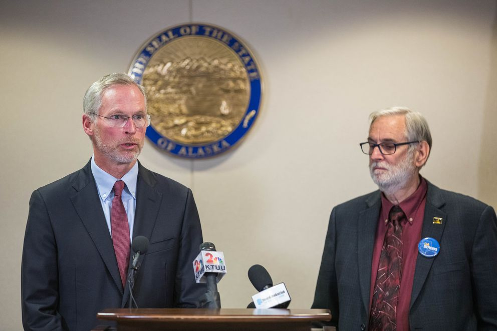 University of Alaska President Jim Johnsen and UA Board of Regents chairman John Davies speak with reporters during a press conference on Tuesday, Aug. 13, 2019. (Loren Holmes / ADN)