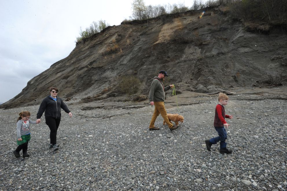 Andy and Stephanie Underwood took a walk along the beach near the eroding Point Woronzof bluff with their children Ledger, 5 and Ruby, 3, and a Goldendoodle puppy Stanley on an overcast Monday afternoon, May 13, 2019. (Bill Roth / ADN)