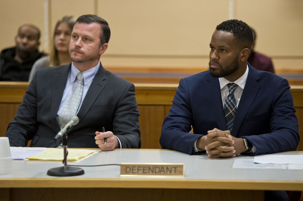 Anchorage Police officer Cornelius Aaron Pettus, right, is arraigned on assault charges in Anchorage on Friday. Attorney Clint Campion is at left. (Marc Lester / ADN)