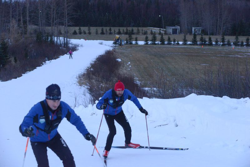 Dylan Watts and Eric Flora, with Alaska Pacific University's cross-country ski team,test the trails at Anchorage's Kincaid Park on Tuesday. (Bob Hallinen / ADN)