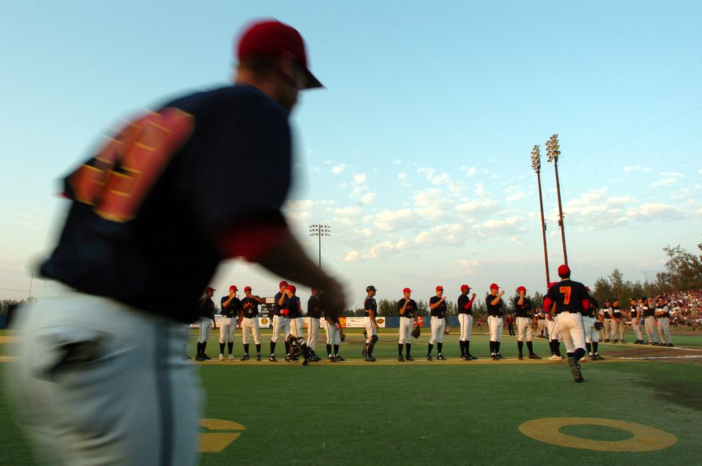 The Goldpanners take to the field for introductions before the start of the 100th Midnight Sun Game. The summertime tradition has been played every year in Fairbanks since 1906. (Jim Lavrakas / ADN)
