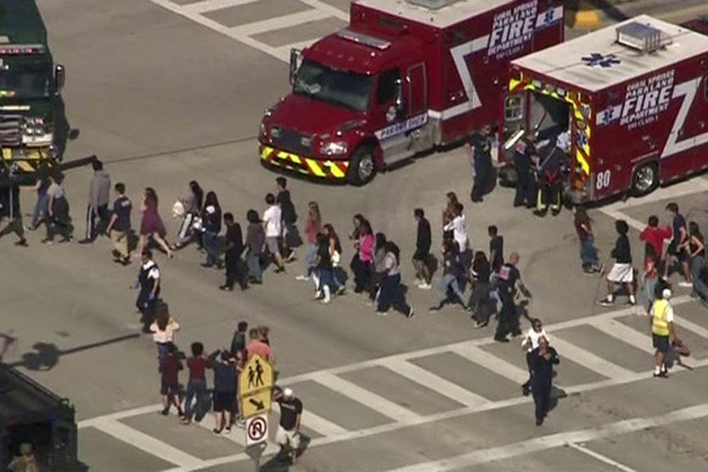 Students are evacuated from Marjory Stoneman Douglas High School in Parkland, Florida, during a shooting on Feb. 14, 2018, in a still image from video. (WSVN.com via REUTERS)