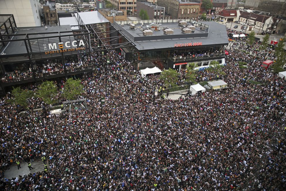Fans gather in the Deer District for Game 6 of the NBA Finals between the Milwaukee Bucks and the Phoenix Suns at Fiserv Forum on Tuesday, July 20, 2021, in Milwaukee. (Angela Peterson/Milwaukee Journal-Sentinel via AP)