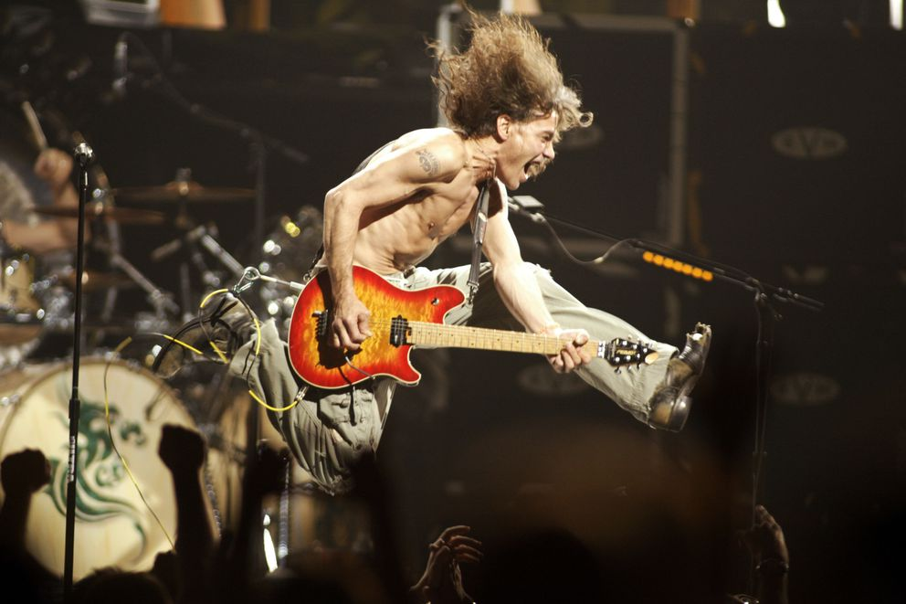 FILE - In this June 22, 2004, file photo, Eddie Van Halen plays the final chord of 'Jump ' during the Van Halen concert at the Continental Airlines Arena in East Rutherford, N,.J. Eddie Van Halen, the guitar virtuoso whose blinding speed, control and innovation propelled his band Van Halen into one of hard rock's biggest groups, died Tuesday, Oct. 6, 2020. Van Halen, who had battled cancer, was 65. (John Munson/NJ Advance Media via AP)