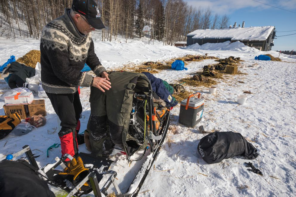 Jeff King rests his team in Grayling during the 2018 Iditarod Trail Sled Dog Race. (Loren Holmes / ADN archive)