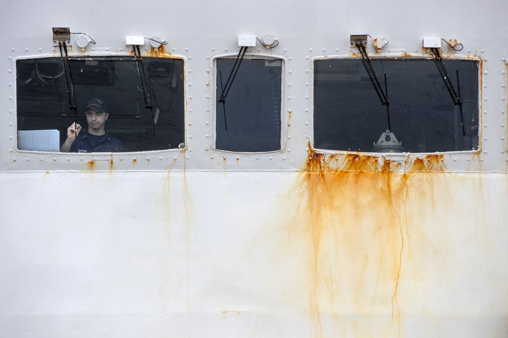 Rust stains the Polar Star's bridge, where Lt. Sam Krakower, the ship's assistant operations officer, writes vessel traffic updates on windshield glass. (Brian van der Brug / Los Angeles Times/TNS)