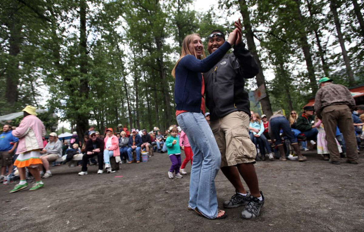 Samart Turner and Hope Froderman dance to Gordie Tentrees on Saturday, July 2, 2011 at the Girdwood Forest Fair. (Steph Anderson / Anchorage Daily News)