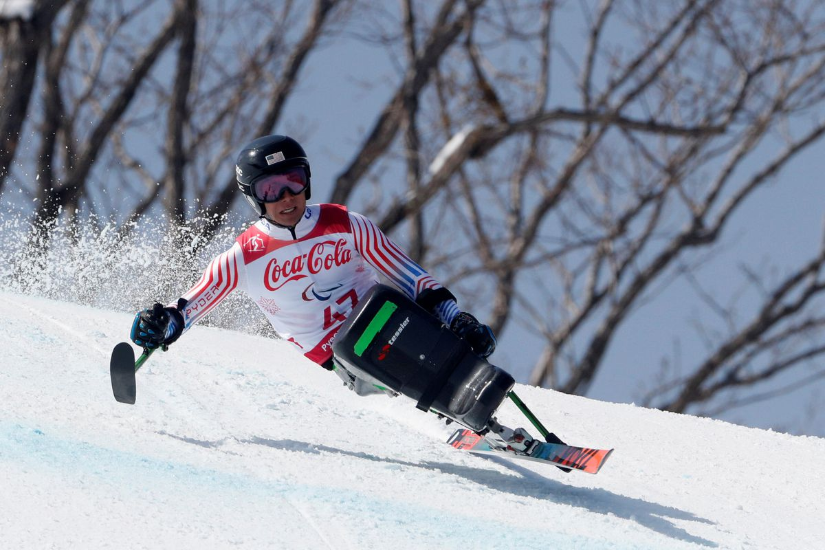 Alaska's Andrew Kurka carries speed around a corner on his way to the gold medal in the sit-ski downhill race at the Paralympics Games in Pyeongchang, South Korea.  (Paul Hanna / Reuters)