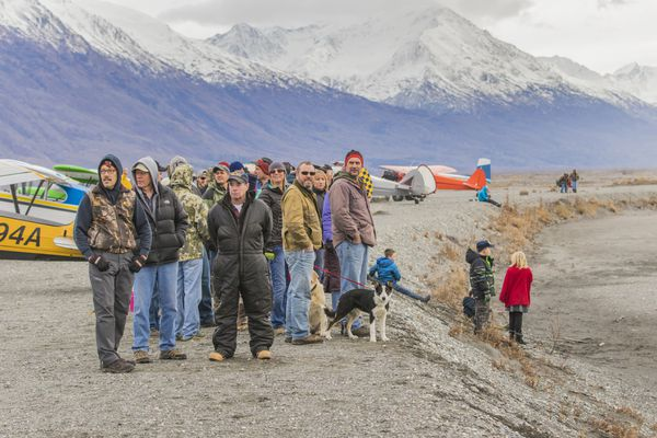 Pilots, friends and family gathered at the Great Alaskan Pumpkin Drop, Saturday Oct. 28, 2017. The third annual event was on the Knik River gravel bars. (Cory Kittle) ONE TIME USE