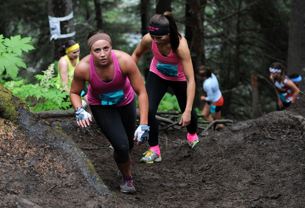 Lauren Bassler of Anchorage begins her climb of Mount Marathon in the women's race in 2013. The trail she is on is one of many on the lower half of the mountain. (Erik Hill / ADN archive 2013)