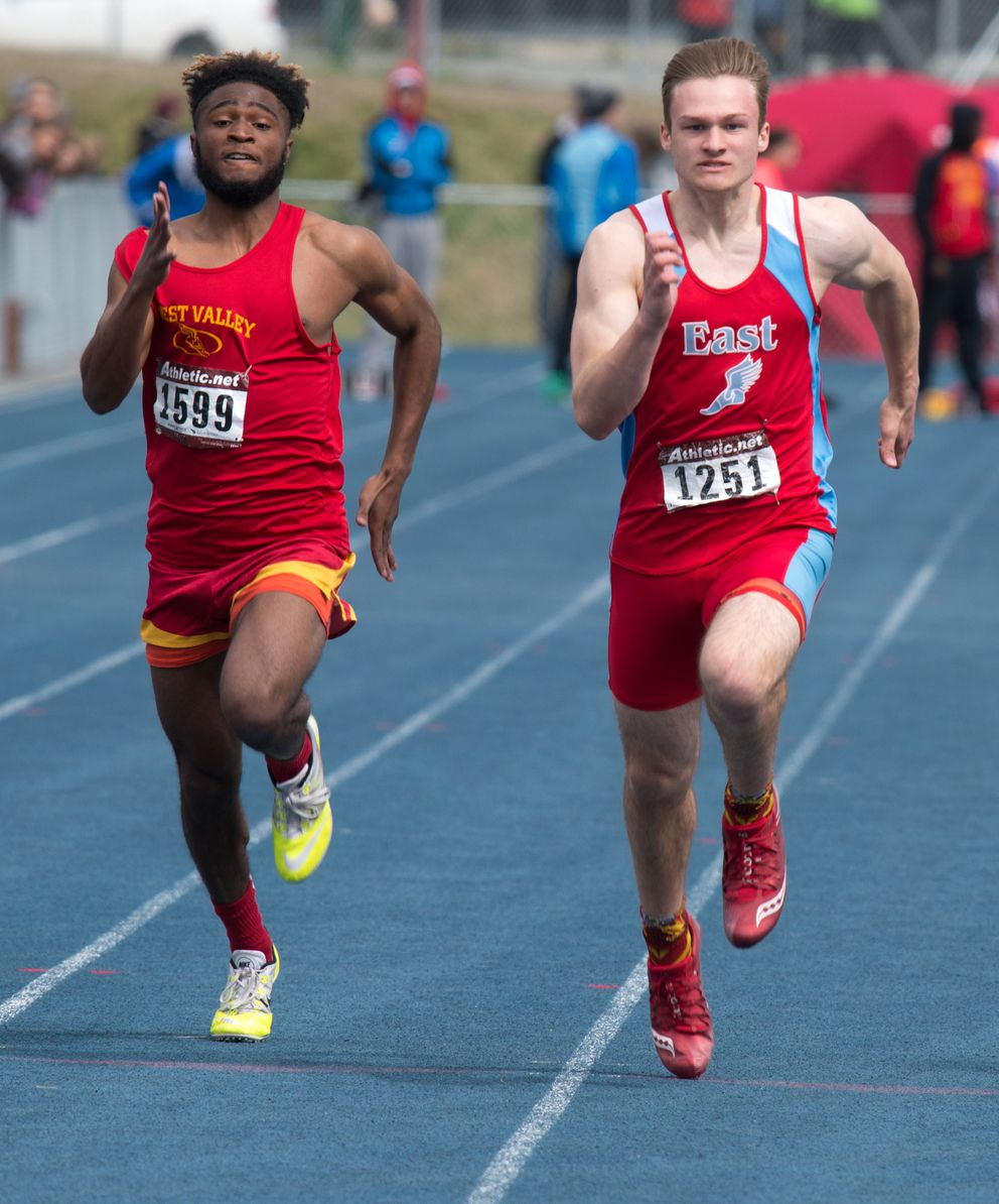 East's Colton Herman, right, leads West Valley's Xavier Simon on his way to victory in the boys 100 meters. (Photo by Stephen Nowers)
