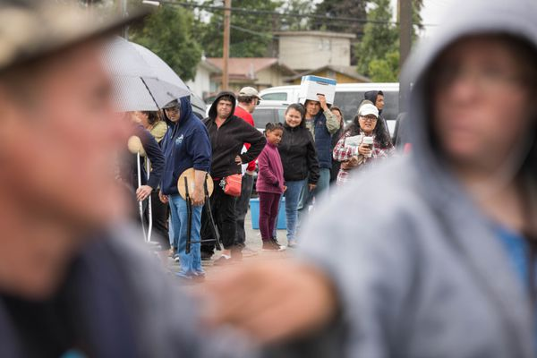 People wait in line to receive food from the Mobile Food Pantry on Saturday. (Loren Holmes / Alaska Dispatch News)