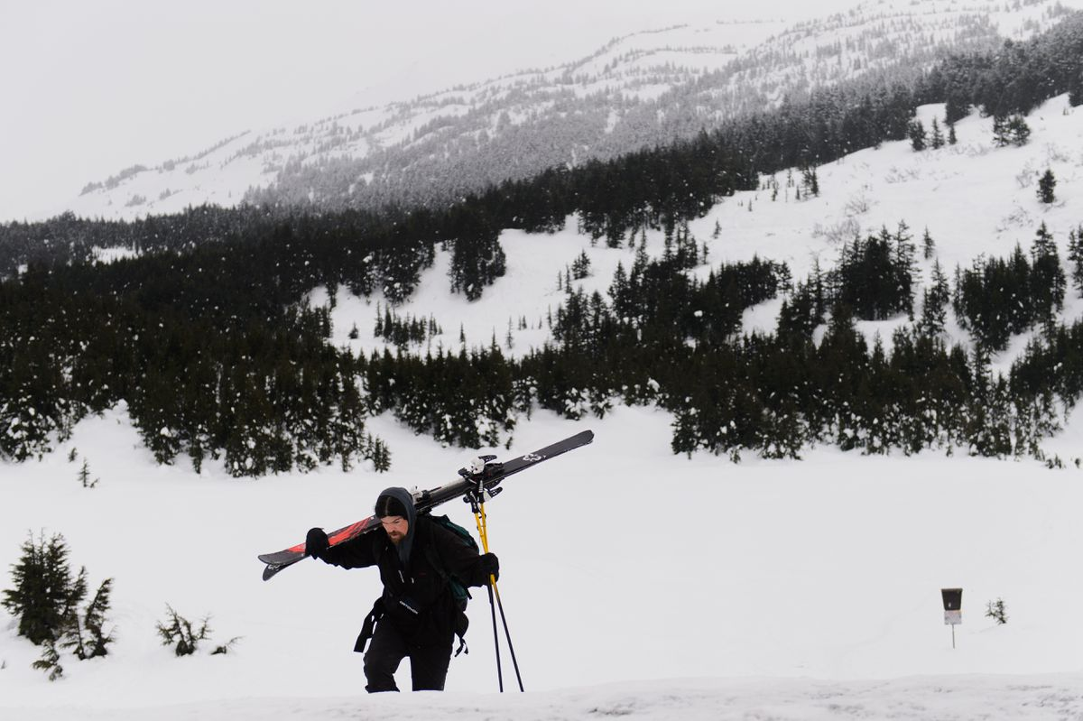Matt Suddock, of Anchorage, returns from a backcountry ski as a light rain falls at Turnagain Pass on Wednesday. The Chugach National Forest Avalanche Information Center continues to operate during the partial government shutdown. Information and advisories about conditions at Turnagain Pass and other areas can be found at cnfaic.org. (Marc Lester / ADN)